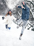 Young couple playing outdoors Stock Photos