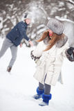 Young couple playing outdoors Stock Images