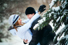 Young couple playing outdoors. Winter season. Stock Photo