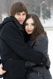 Young couple playing outdoors. Winter season. Royalty Free Stock Photography