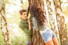 Young Couple Playing In The Park Stock Images