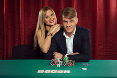 Young couple playing poker at the casino Royalty Free Stock Image
