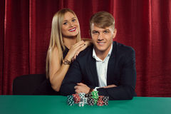 Young couple playing poker at the casino Royalty Free Stock Photos