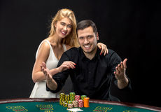 Young couple playing poker have a good time in casino Royalty Free Stock Photography