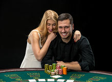 Young couple playing poker have a good time in casino Royalty Free Stock Image