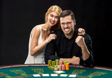 Young couple playing poker have a good time in casino Stock Images