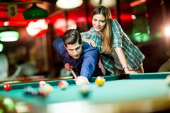 Free Young Couple Playing Pool Stock Images - 53149034