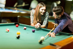 Young couple playing pool Stock Photography