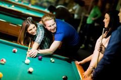 Young couple playing pool Royalty Free Stock Images
