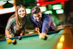 Young couple playing pool Stock Photos