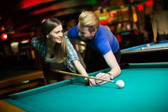 Young couple playing pool Stock Photo