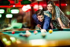 Young couple playing pool Stock Images