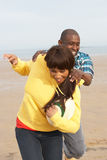Young Couple Playing Rugby On Autumn Beach Holiday Royalty Free Stock Photo