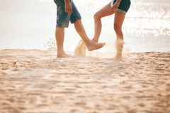 Young couple playing with sand. Summer lifestyle. feet in the sand on the beach stock photography