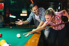 Free Young Couple Playing Snooker Together In Bar Stock Image - 109541951