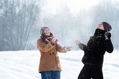 Young couple playing with snow. Winter collection: young couple in winter Stock Photos