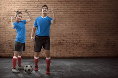 Young couple playing street soccer Stock Photos