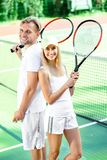 Young couple playing tennis Stock Photo