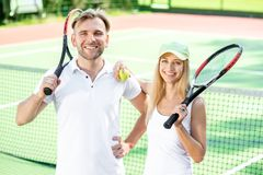 Young couple playing tennis Stock Image