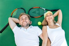Young couple playing tennis Royalty Free Stock Image