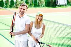 Young couple playing tennis Stock Photos