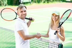 Young couple playing tennis Stock Photography
