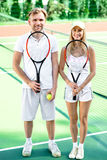 Young couple playing tennis Royalty Free Stock Photos