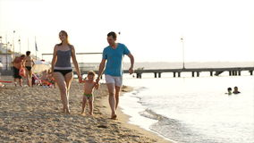 Young couple playing with their son at the seaside Stock Photo