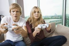 Young couple playing video game in living room at home Royalty Free Stock Image