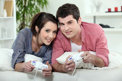 Young couple playing video games Royalty Free Stock Images