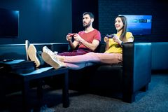 Couple playing video games with gaming console in the club royalty free stock images