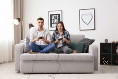 Young couple playing video games. At home Stock Image