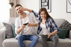 Young couple playing video games. At home Stock Photography