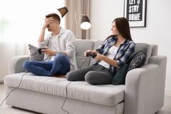 Young couple playing video games. At home Royalty Free Stock Photo