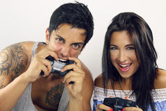 Young couple playing video games. Two people playing video games over a white background Royalty Free Stock Image
