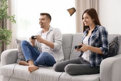 Young couple playing video games. At home Royalty Free Stock Images
