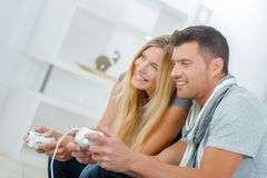 Young couple playing video games. Young Stock Photos