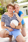 Young Couple Playing Volleyball Match Stock Photos