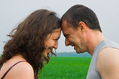 Young couple playing in a wheat field Royalty Free Stock Image
