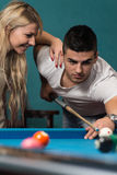 Young Couple Plays Billiards Royalty Free Stock Image