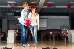 Young couple plays bowling Royalty Free Stock Images
