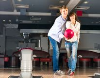 Young couple plays bowling Royalty Free Stock Photography