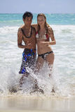 Young couple plays in the surf Stock Image