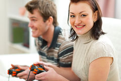 Young couple plying on console Stock Photography
