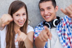 Young couple pointing Stock Photos
