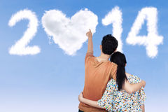 Young couple pointing at 2014 Royalty Free Stock Photo