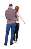 Young couple pointing. Royalty Free Stock Photo