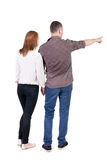 Young couple pointing. Royalty Free Stock Photos