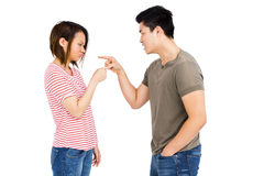 Young couple pointing at each other while having an argument Royalty Free Stock Photography