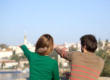 Young couple pointing fingers into the distance Stock Image